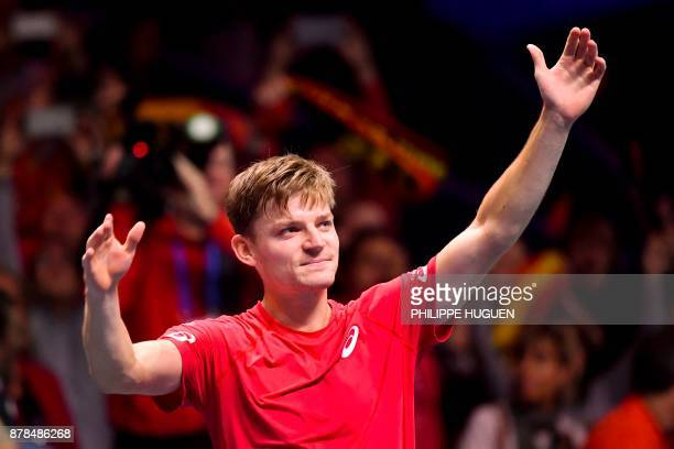 TOPSHOT Belgium's David Goffin reacts after winning a match against France's Lucas Pouille during the Davis Cup World Group singles rubber final...