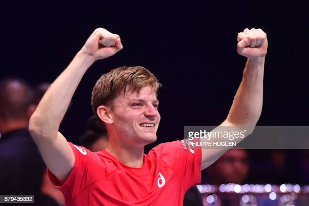 Belgium's David Goffin reacts after winning his singles rubber 4 against France's JoWilfried Tsonga at the Davis Cup World Group final tennis match...