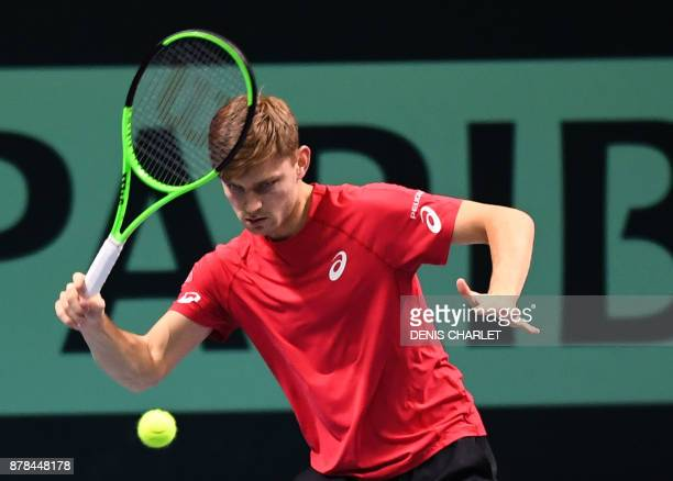 Belgium's David Goffin returns a ball to France's Lucas Pouille during the Davis Cup World Group singles rubber final tennis match between France and...