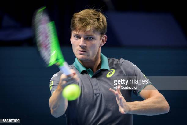 Belgium's David Goffin returns a ball to Germany's Peter Gojowczyk during their match at the Swiss Indoors ATP 500 tennis tournament on October 24...