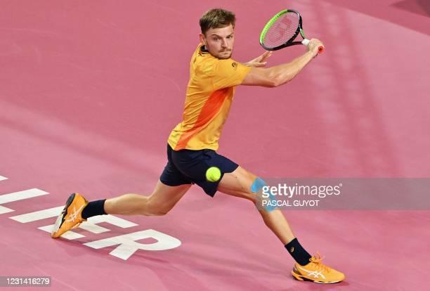 Belgium's David Goffin returns the ball to Belarus's Egor Gerasimov during the Open Sud de France ATP World Tour event semi-final tennis match in...