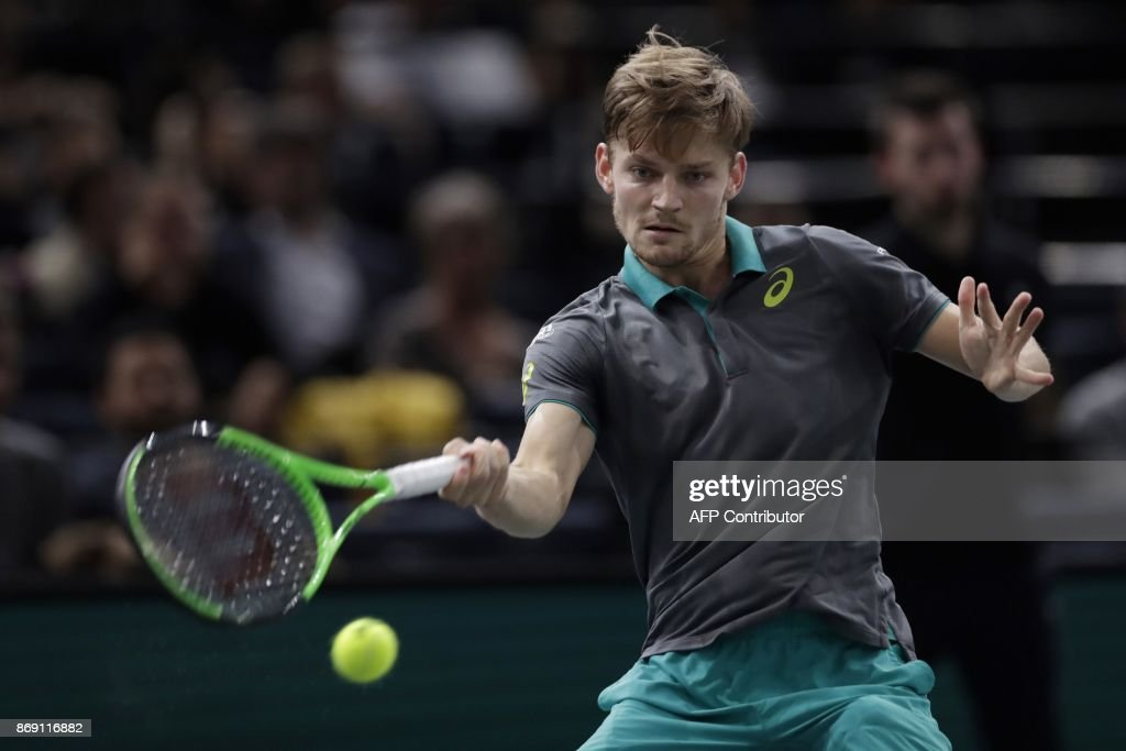 Belgium's David Goffin returns the ball to France's Adrian Mannarino during their second round match at the ATP World Tour Masters 1000 indoor tennis tournament on November 1, 2017 in Paris. / AFP PHOTO / Thomas SAMSON