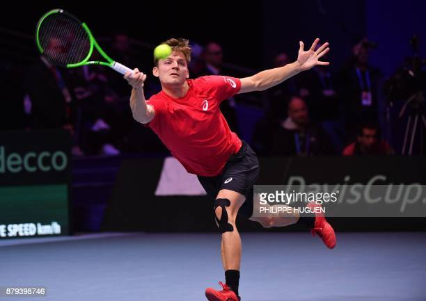 Belgium's David Goffin returns the ball to France's JoWilfried Tsonga during their singles rubber 4 of the Davis Cup World Group final tennis match...