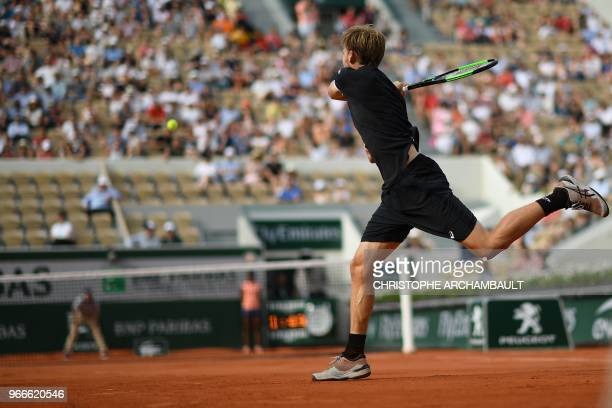 Belgium's David Goffin returns the ball to Italy's Marco Cecchinato during their men's singles fourth round match on day eight of the Roland Garros...