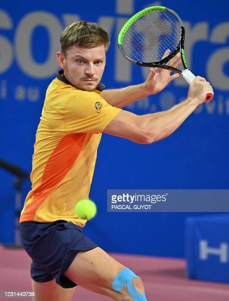 Belgium's David Goffin returns the ball to Spain's Roberto Bautista Agut during the final match of the ATP World Tour Open Sud de France tennis...