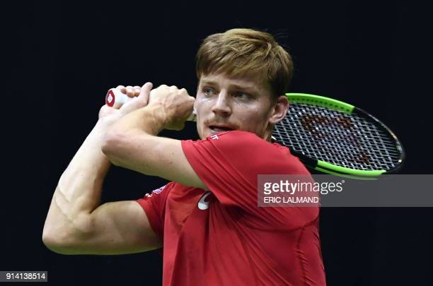 Belgium's David Goffin returns to Hungary's Marton Fucsovics during their tennis match as part of the Davic Cup World group tie between Belgium and...