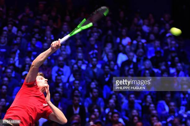 Belgium's David Goffin serves the ball to France's Jo-Wilfried Tsonga during their singles rubber 4 of the Davis Cup World Group final tennis match...