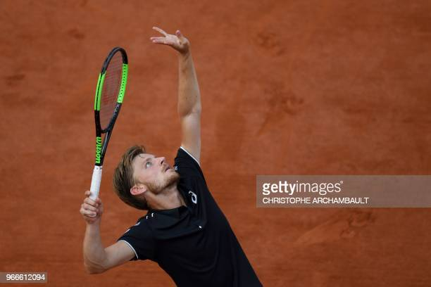Belgium's David Goffin serves the ball to Italy's Marco Cecchinato during their men's singles fourth round match on day eight of the Roland Garros...