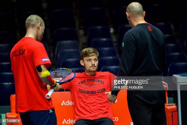 Belgium's David Goffin speak with Belgium's Steve Darcis and Belgium's captain Johan Van Herck during a training session at the PierreMauroy Stadium...