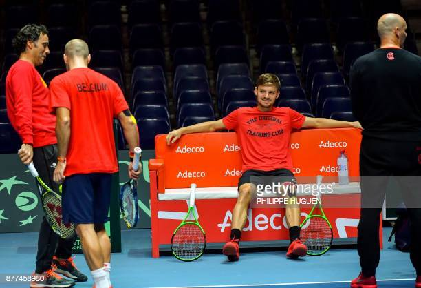 Belgium's David Goffin speaks with Belgium's Steve Darcis and Belgium's captain Johan Van Herck during a training session at the Pierre-Mauroy...