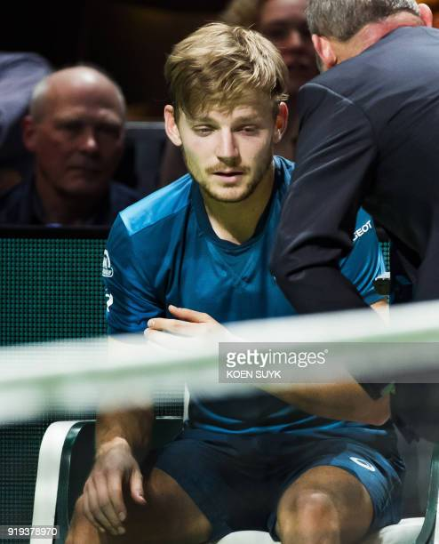 Belgium's David Goffin withdraw during his match against Bulgaria's Grigor Dimitrov during their semi final match of the ABN Amro World Tennis...