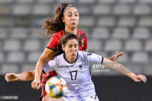 Belgium's defender Amber Tysiak and Albania's forward Kristina Maksuti fight for the ball during the 2023 FIFA Women's World Cup qualifying football...