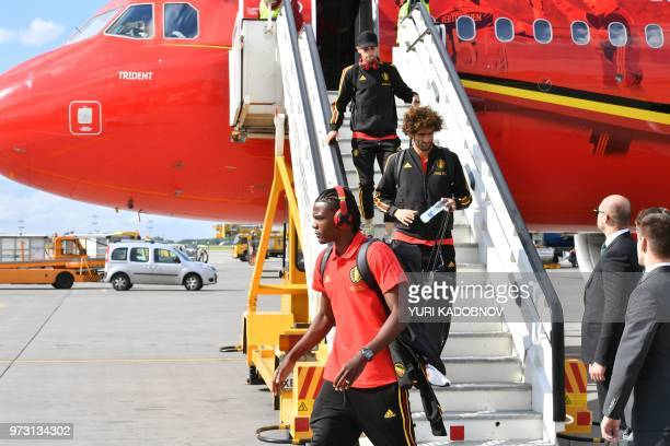 Belgium's defender Dedryck Boyata Belgium's midfielder Marouane Fellaini disembark from a plane upon the team's arrival at Moscow's Sheremetyevo...