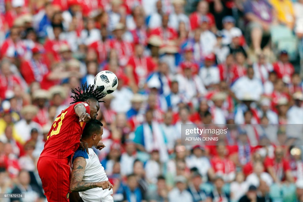 Belgium's defender Dedryck Boyata (L) heads the ball with Panama's forward Blas Perez during the Russia 2018 World Cup Group G football match between Belgium and Panama at the Fisht Stadium in Sochi on June 18, 2018. (Photo by Adrian DENNIS / AFP) / RESTRICTED