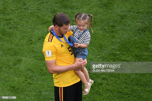 Belgium's defender Jan Vertonghen carries his daughter Leyla after their Russia 2018 World Cup playoff for third place football match between Belgium...