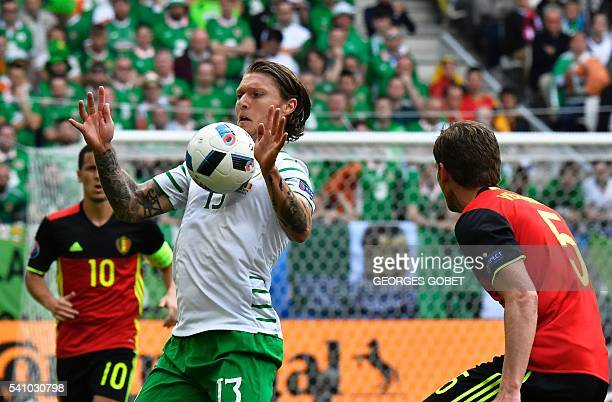 Belgium's defender Jan Vertonghen challenges Ireland's midfielder Jeffrey Hendrick during the Euro 2016 group E football match between Belgium and...