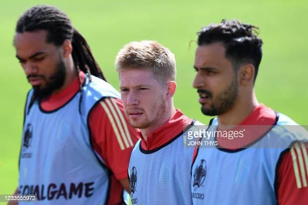 Belgium's defender Jason Denayer, Belgium's midfielder Kevin De Bruyne and Belgium's midfielder Nacer Chadli arrive to the MD-1 training session at...