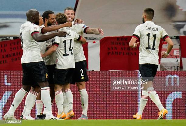 Belgium's defender Jason Denayer celebrates scoring the opening goal with his teammates during the UEFA Nations League football match between Denmark...