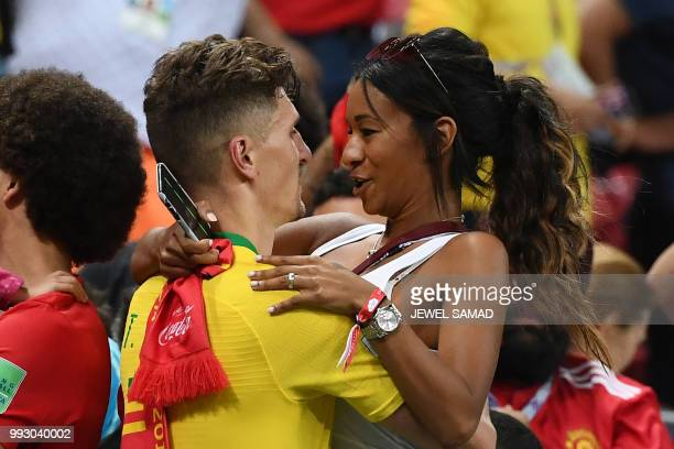 TOPSHOT Belgium's defender Thomas Meunier celebrate with his girlfriend Deborah Panzokou after the Russia 2018 World Cup quarterfinal football match...