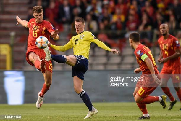 Belgium's defender Thomas Meunier fights for the ball with Scotland's midfielder Callum McGregor during the UEFA Euro 2020 qualification football...