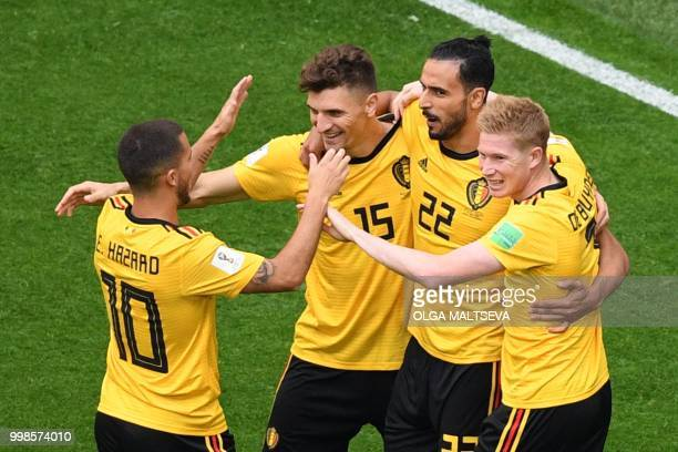 TOPSHOT Belgium's defender Thomas Meunier is congratulated by teammates after scoring during their Russia 2018 World Cup playoff for third place...