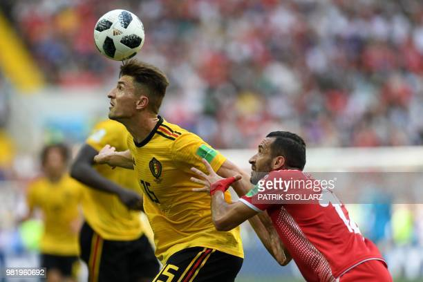TOPSHOT Belgium's defender Thomas Meunier is marked by Tunisia's defender Ali Maaloul during the Russia 2018 World Cup Group G football match between...