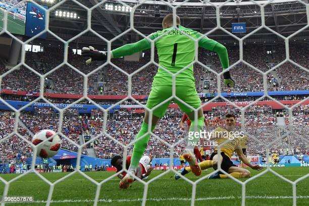 TOPSHOT Belgium's defender Thomas Meunier scores past England's goalkeeper Jordan Pickford during their Russia 2018 World Cup playoff for third place...