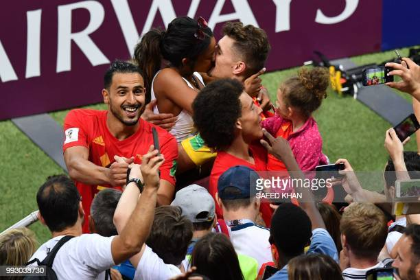 Belgium's defender Thomas Meunier shares a kiss with his girlfriend Deborah Panzokou at the end of the Russia 2018 World Cup quarterfinal football...