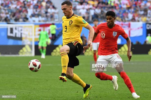 Belgium's defender Thomas Vermaelen fights for the ball with England's forward Marcus Rashford during their Russia 2018 World Cup playoff for third...