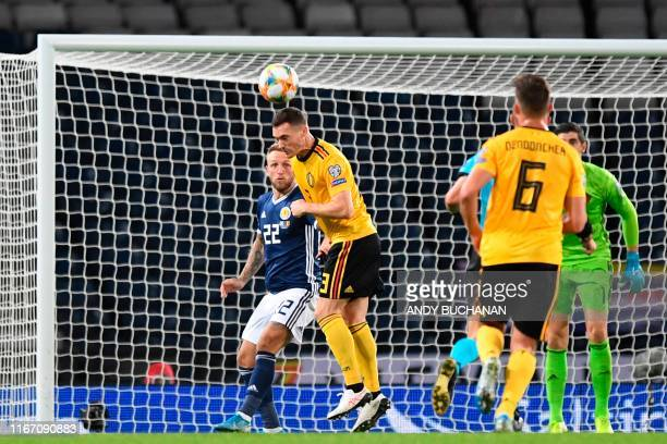 Belgium's defender Thomas Vermaelen heads the ball off the line during the Euro 2020 football qualification match between Scotland and Belgium at...