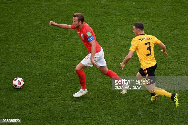Belgium's defender Thomas Vermaelen marks England's forward Harry Kane during their Russia 2018 World Cup playoff for third place football match...