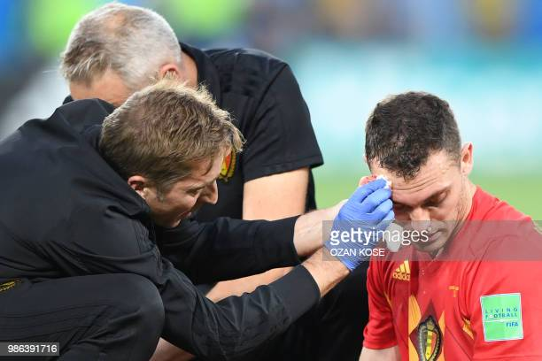 Belgium's defender Thomas Vermaelen receives medical attention after resulting injured during the Russia 2018 World Cup Group G football match...