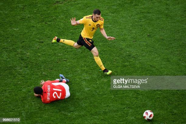 Belgium's defender Thomas Vermaelen vies for the ball with England's midfielder Ruben LoftusCheek during their Russia 2018 World Cup playoff for...