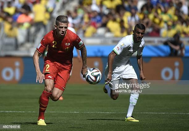 Belgium's defender Toby Alderweireld and Algeria's forward Riyad Mahrez vie for the ball during a Group H football match between Belgium and Algeria...
