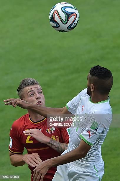 Belgium's defender Toby Alderweireld challenges Algeria's forward Riyad Mahrez during the Group H football match between Belgium and Algeria at the...