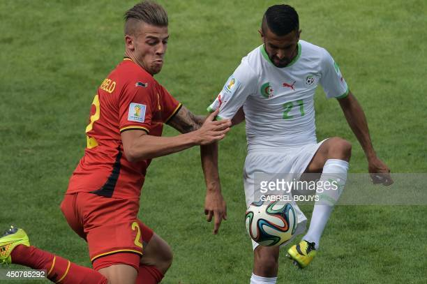 Belgium's defender Toby Alderweireld vies for the ball against Algeria's forward Riyad Mahrez during the Group H football match between Belgium and...