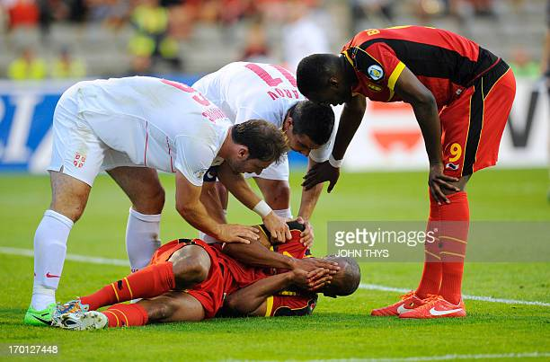 Belgium's defender Vincent Kompany reacts after being injured during the 2014 World Cup Qualifying football match between Belgium and Serbia at the...