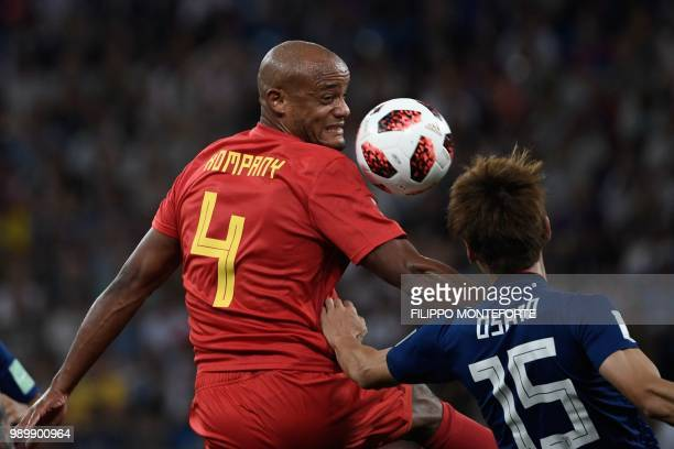 Belgium's defender Vincent Kompany vies for the ball with Japan's forward Yuya Osako during the Russia 2018 World Cup round of 16 football match...