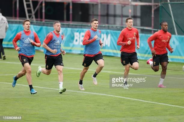 Belgium's defenders Leander Dendoncker, Toby Alderweireld, Thomas Meunier, midfielder Hans Vanaken and froward Michy Batshuayi take part in a...