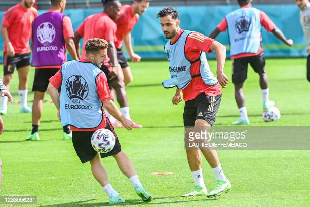 Belgium's Dries Mertens and Belgium's Nacer Chadli fight for the ball during a training session of the Belgian national soccer team Red Devils, in...