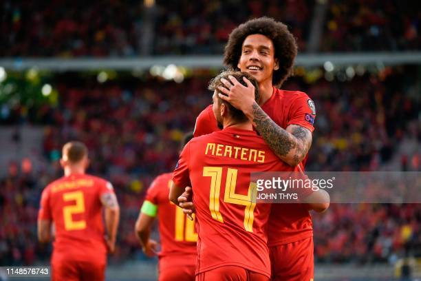 Belgium's Dries Mertens celebrates with Belgium's midfielder Axel Witsel after scoring a goal during the UEFA Euro 2020 qualification football match...