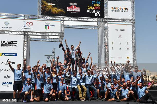 Belgium's driver Thierry Neuville and compatriot codriver Nicolas Gilsoul of Hyundai i20 Coupe WRC celebrate thier victoty on the podium during the...