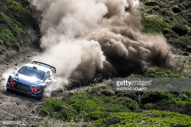 TOPSHOT Belgium's driver Thierry Neuville and compatriot codriver Nicolas Gilsoul steer their Hyundai i20 Coupe WRC during the race at Argentiera...