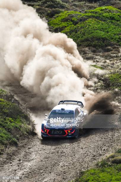Belgium's driver Thierry Neuville and compatriot codriver Nicolas Gilsoul steer their Hyundai i20 Coupe WRC during the race at Argentiera near...