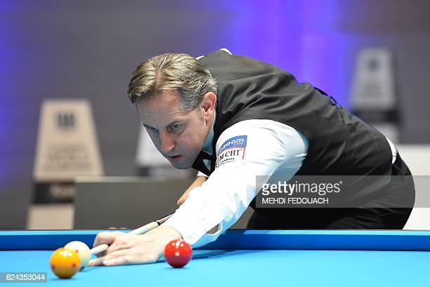 Belgium's Eddy Leppens competes in the semifinal of the 69th World Championship Three Cushion Individuals in Bordeaux on November 19 2016 / AFP /...