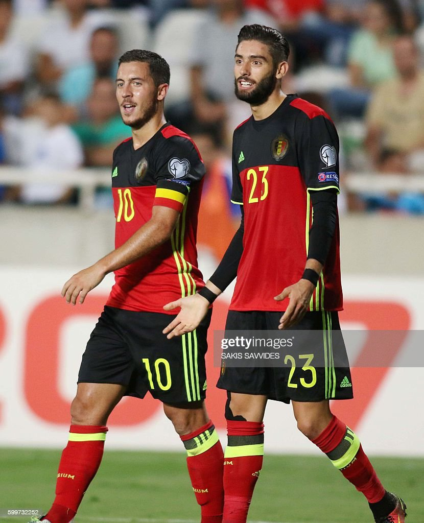 Belgium's Eden Hazard (L) and Yannick Carrasco celebrate after the latest scored a goal during the World Cup 2018 Europe qualifying football match Cyprus versus Belgium on September 6, 2016 at the GSP Stadium in Nicosia. / AFP / Sakis Savvides