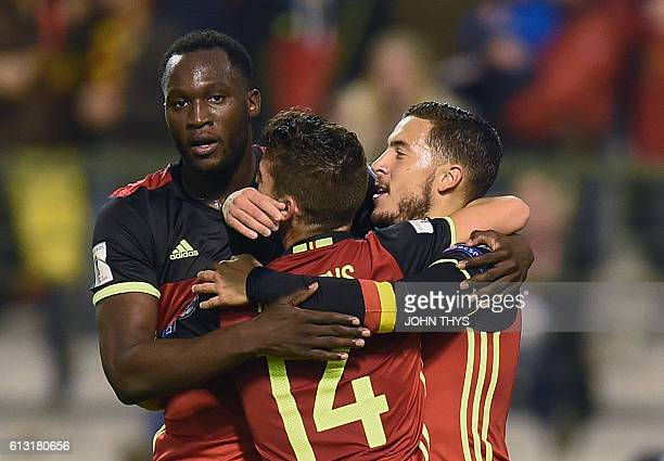 Belgium's Eden Hazard celebrates with teammates after scoring during the Fifa WC 2018 football qualification match between Belgium and Bosnia and...