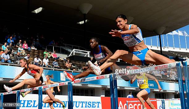 Belgium's Eline Berings France's Aisseta Diawara and Italy's Marzia Caravelli compete in heat 3 of the women's 100m hurdles qualifications at the...