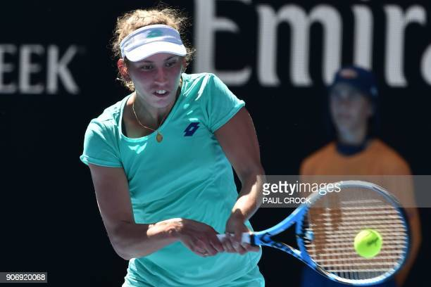 Belgium's Elise Mertens hits a return against France's Alize Cornet during their women's singles third round match on day five of the Australian Open...