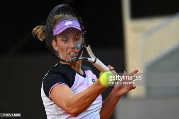 Belgium's Elise Mertens returns the ball to Belarus' Aryna Sabalenka during their 2021 WTA Tour Madrid Open tennis tournament singles match at the...